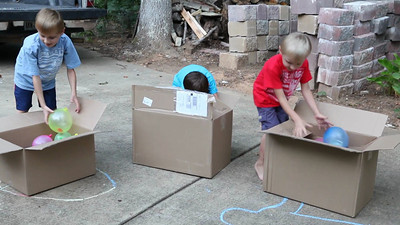 Samuel, Caleb, and Reese open their boxes from Aunt Donalda, Uncle Casey, and Aunt Renee.