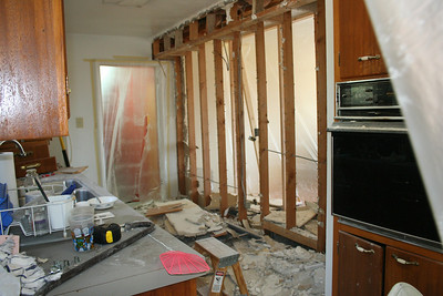 Day Three: Sheetrock of Kitchen South Wall torn out.