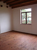 The master bedroom corner. It is quite large. The floors are handsawn wood.