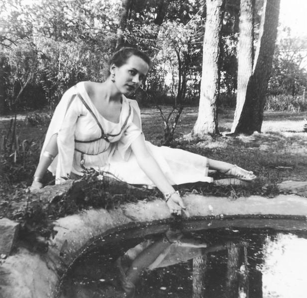 "Lani on ""Latin Day"" at Fish Pond in Grandma Boyd's Backyard (1954)"