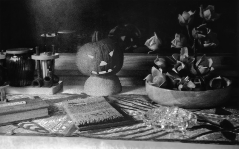 Very clever still life created by Mother in 1947. In addition to the pumpkin, key elements in this picture are the wood roses in a Koa-wood bowl, tapa cloth that Dad brought back from the South Pacific, his pipe collection and a tobacco bowl. I sort of recognize the hand towel on the book in the foreground, and I am certain that both books and what appears to be a measuring stick mean something.
