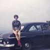Judy on Emmett's car. 1958.