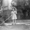 Lani raking in our yard in Red Bluff. (1947)