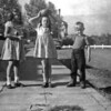 """Gretchen Wetter, Lani and Bob by our home at 931 Rio St. in 1947. Printed note says """"?, Lani, Bobby, Pearl Harbor, 1946"""". Seems unlikely. Printing is not my mother's. Print stamped """"039"""", the same as others in this group."""