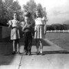"""Gretchen Wetter, Lani and Bob by our home at 931 Rio St. in 1947. Printed note says """"??, Bobby, Lani (Maybe 1946)"""". Seems unlikely. Printing is not my mother's. Print stamped """"039"""", the same as others in this group."""