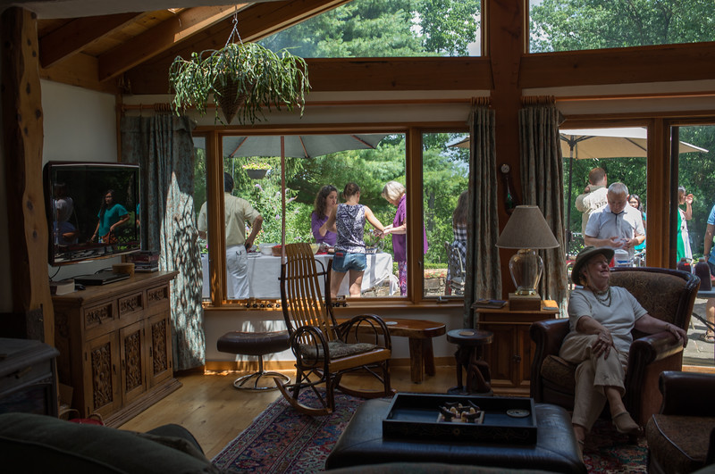 The view from inside the Sackett's house ... SuHelen (another fast moving target) is seen with Heidi and Veronika setting up a table. Nancy is inside enjoying the shade. Han is texting.