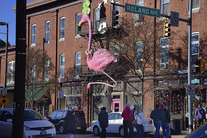 A Giant Pink Flamingo and Mr Boh adorn the outside of Baltimore landmark, the Cafe Hon