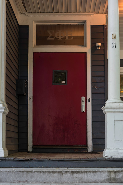 The Red Door is Faded and in Weather-Beaten