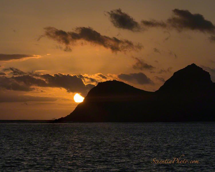 Sunrise behind Mokulua Nui