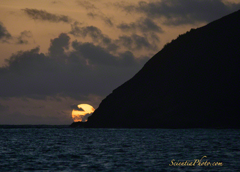 The Sun Sits on the Horizon beyond Mokulua Iki. (Taken from Lanikai Beach)
