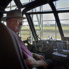 Bob with Howard Hughes Hat at Controls of the Spruce Goose