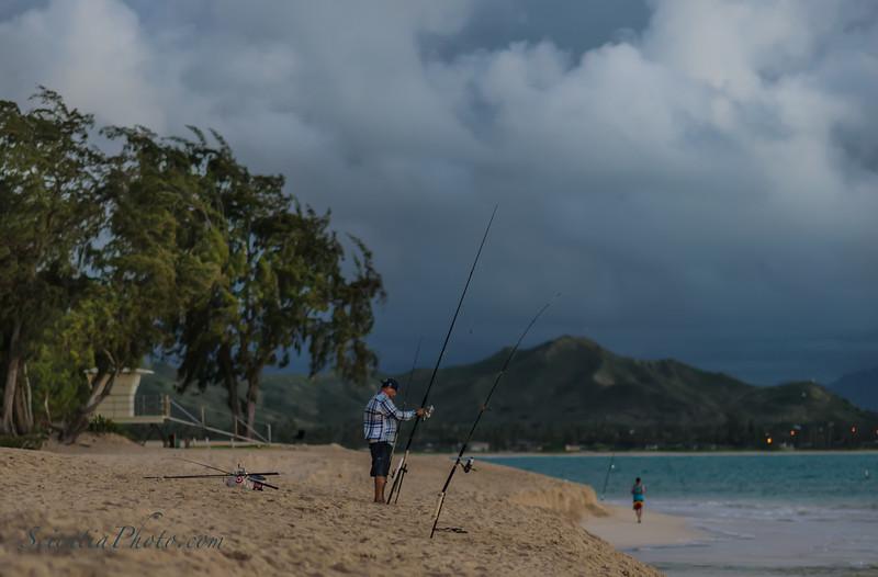 Fisherman at Kailua Beach Park at Dawn