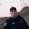 This Dam! Police officer let me take his picture and we talked for a bit. He's been with the dam for about 10 years and boy does he have some stories.<br /> <br /> You'd think that being an officer for a place like the Hoover Dam would be a piece of donut, but it's not as easy as it seems.  Imagine dealing with drunken tourists and suicide jumpers on a regular basis.