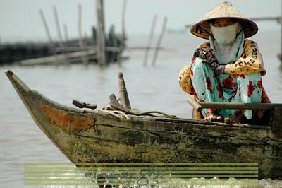 Lady in Boat, Cambodia