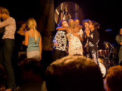 Angelique Kidjo hugging audience