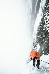 "Descending a Sea of Vapours. Rappelling from the notorious ice climb named ""Sea of Vapours"" on Mt. Rundle."