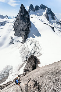 The steep granite spires tower above the glaciers. Great alpine climbing on Snowpatch Spire (Pigeon Spire and Howser Towers in the background). Bugaboo Provincial Park.