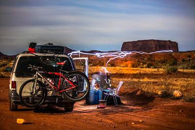 A headlamp illuminates the area as we prepare dinner in the desert. Near Moab, Utah.
