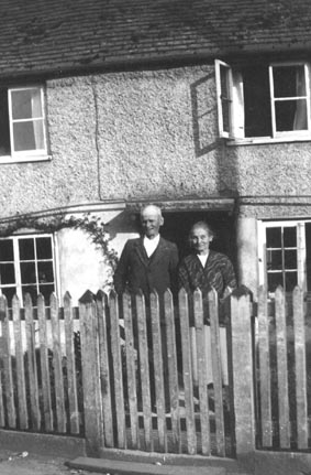 <font size=3><u> - The Aldridges at Wisteria Cottage - 1927 - </u></font> (BS0215)  Mr and Mrs Aldridge outside Wisteria Cottage.