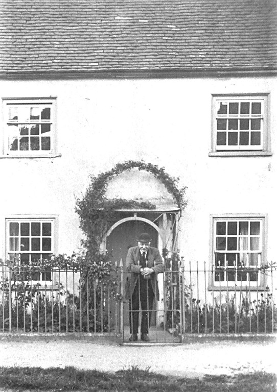 "<center><font size=3><u> - Mr Thomas Pether - </u></font> (BS0341)  Mr Thomas Pether leaning on the gate of his house formerly between The White Hart Hotel and the Castle Farmhouse and called Fairlight.  To his right and between his property and the Hotel was a wooden shed used as both the location of the old fire engine (see BS0052) and a morgue.  All three buildings are clearly shown on BS0330.  Mr Pether's son was George Pether who later became the Landlord of the ""Three Horseshoes"" pub between 1937 and 1952 - see ""Benson A Century of Change"", page 211.  </center>"