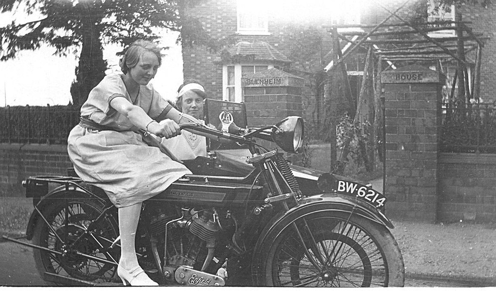 <center><font size=3><u> - Joyce Jenkins -  </u></font> (BS0295)  Joyce tries her brother Maurice Jenkins motor bike outside Blenheim House, Oxford Road in the 1920's.. <center>