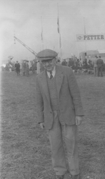 "<center><font size=3><u> - Bertie West -  </u></font> (BS1148)  Reginald Bertie West was born in 1903 and died in 1980 beqeathing an area of land now known as ""The Bertie West Field"" for a playing field for the children of the village.  He is pictured here at his farm (Castle Farm) at what appears to be some sort of agricultural machinary demonstration.  Can anyone provide more information?</center>"