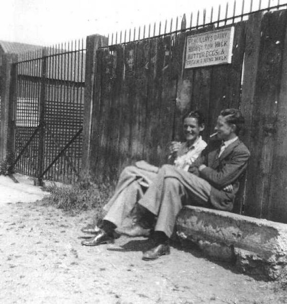 <font size=3><u> - Two Men Sitting - 1930s - </u></font> (BS0060)  On the left is Frank Rudman.     The 2 men are looking at the Thames,sitting at the rear of the coalyard, which  was owned by Mr Weedon, and then Frank Young. It finally closed in the late 40's.