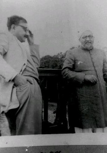 With his father