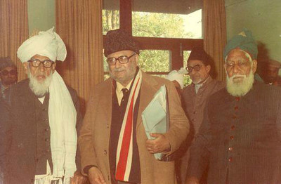 From left to right are a companion of The Promised Messiah (Sahabi), Dr. Abdus Salam, Ch. Shabeer Ahmad (Tehreek-e-Jadeed, wakeel-ul-maal), Molvi Muhammad Hussain Sahib Sahabi