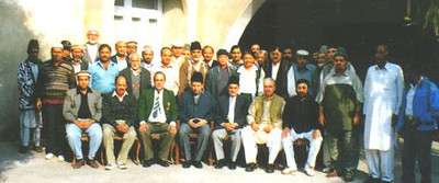 A group photo with Hazrat Mirza Masroor Ahmad before Khilafat
