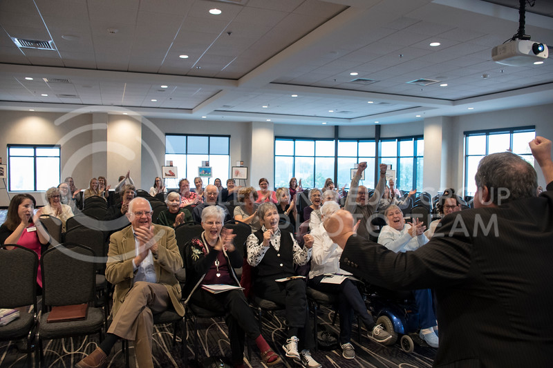 Gary Glazner cheers with the audience for the Personhood and Dementia event at the Bluemont Hotel in Manhattan, KS, on Nov. 2, 2017. (Olivia Bergmeier | Collegian Media Group)