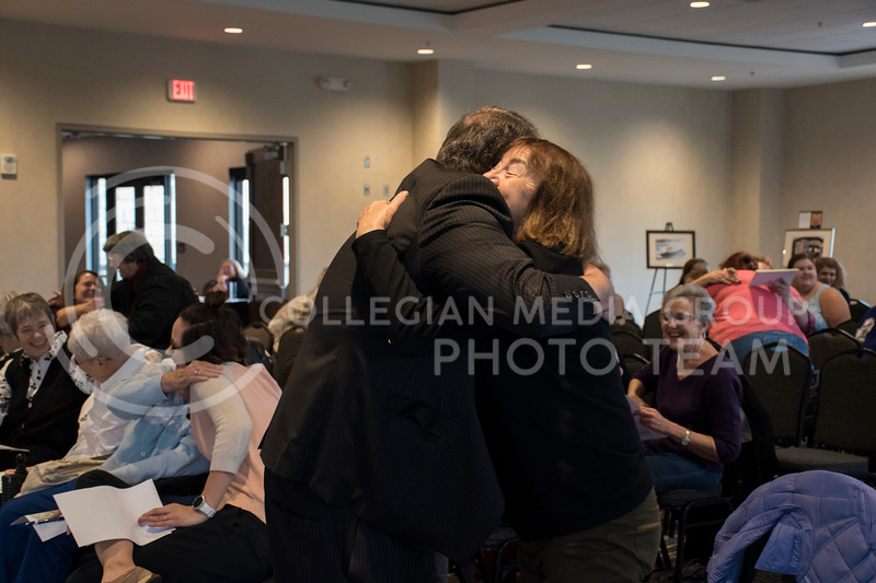Gary Glazner hugs one of the audience members as the rest of the audience hugs one another for the Personhood and Dementia Event at the Bluemont Hotel in Manhattan, KS, on Nov. 2, 2017. (Olivia Bergmeier | Collegian Media Group)