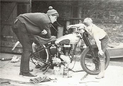 Working on the BSA again, My younger brother Neil looks on from the front and another friend Martin Stokes leans on the seat. I am down behind the back wheel .