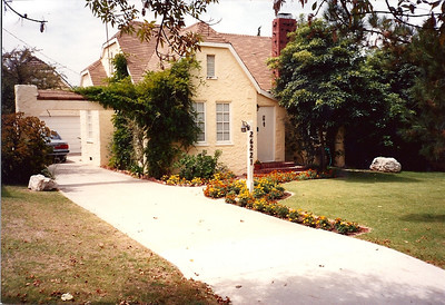 The front of the house with a later model Toyota Cressida and the garden marigolds in full bloom. When we sold the house we had to have the chimney stack taken down and rebuilt because it was damaged in the Northridge earthquake.