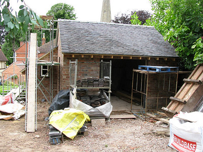A small garage/workshop is built opposite the coach house