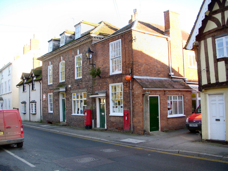 """The Red House"" or Newent Post Office as it stands today. This is where our family grew up. Its changed a lot and just recently the owner after my parents decided to sell up and retire. They cashed in by selling off plots of the garden including the large double story Coach house."