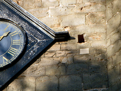 While visiting the Church a mysterious hole appears to the right of the clock and is used by the crows to enter & depart.