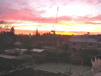 An early morning sunrise shot from my bedroom window where I stayed at my parents house. Through the frost the spire of Newent St Mary's Church along with the construction crane being used to build more homes at the Street's old garage plot.
