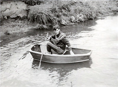 here I test a small wooden dingy at the Wishing Bridges stream that I made at school when I was 15 years old.