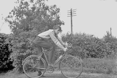 Martin Stokes on his bicycle at his parents home on Ross Road