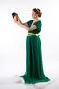 Lady in green handing jug