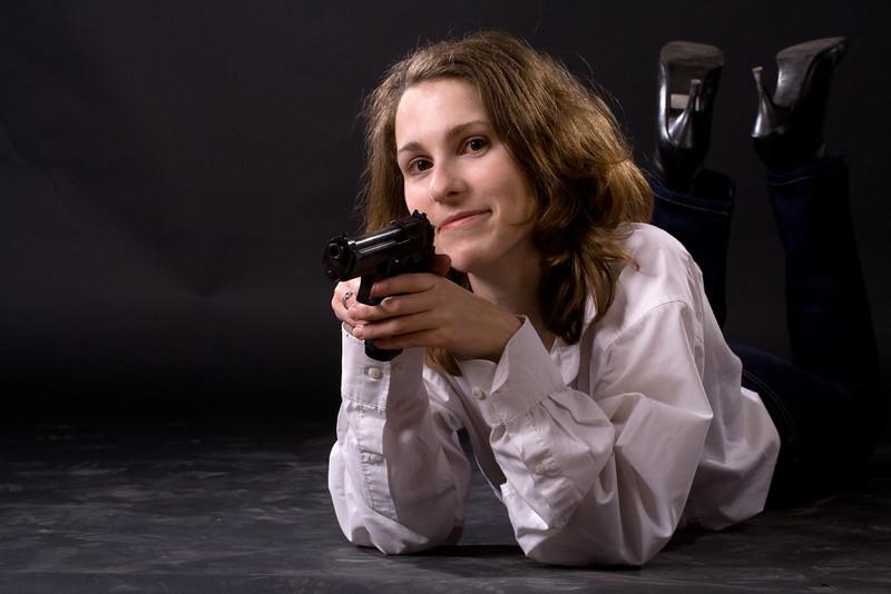 lying woman with gun