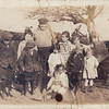Edith Rupard in center back, Sally Lewis in center in front, possible baby Charles or Mildred Lewis in center front.
