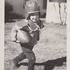 1950-01-xx John L Clark child playing football in yard