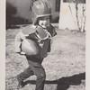1950-01-xx John L Clark child playing football in yard