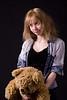 blonde girl with teddy bear