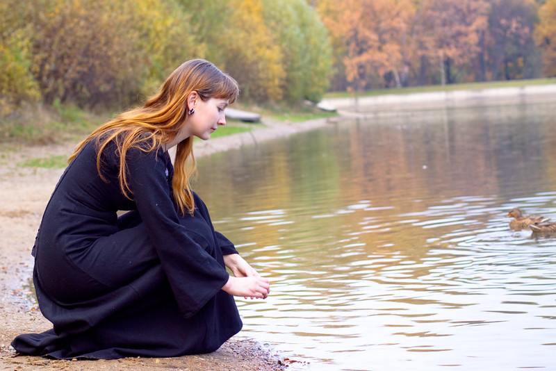 Girl, pond and ducks