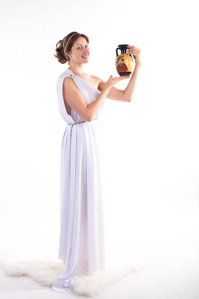 Lady in white handing jug
