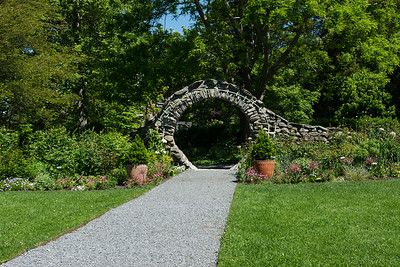 "The ""Moon Gate"", pathway leading to the Blithewold Mansion and gardens."
