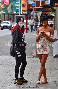 Perth city girls during Covid-19.  It is winter and their attire couldn't be more different from each other.  Gotta love the slippers